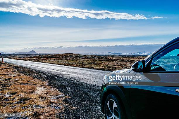Car Parked On Roadside Against Sky