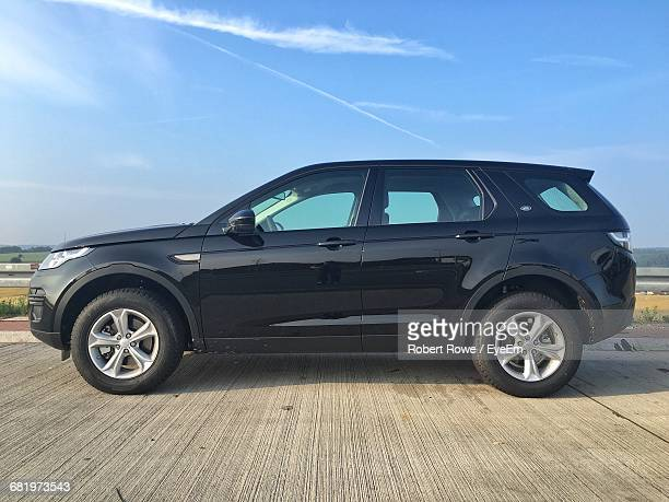 car parked on street against sky - stationary stock pictures, royalty-free photos & images