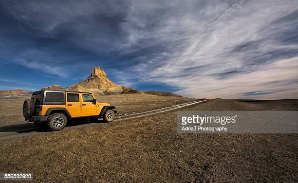 car parked on the dirt road - 4x4 stock pictures, royalty-free photos & images