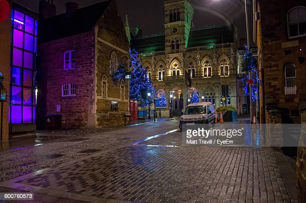 car parked outside buildings at night - northampton stock pictures, royalty-free photos & images