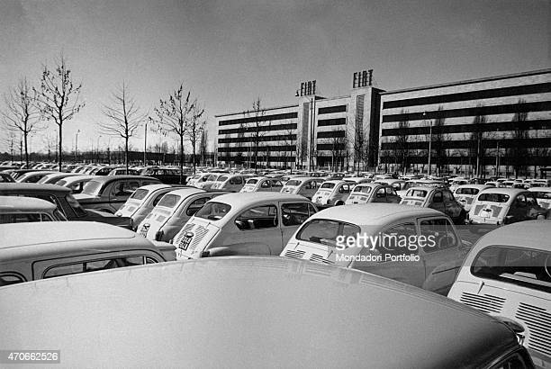 'A car parking in front of one of the Fiat factories the cars are all white Cinquecento Turin March 1963 '