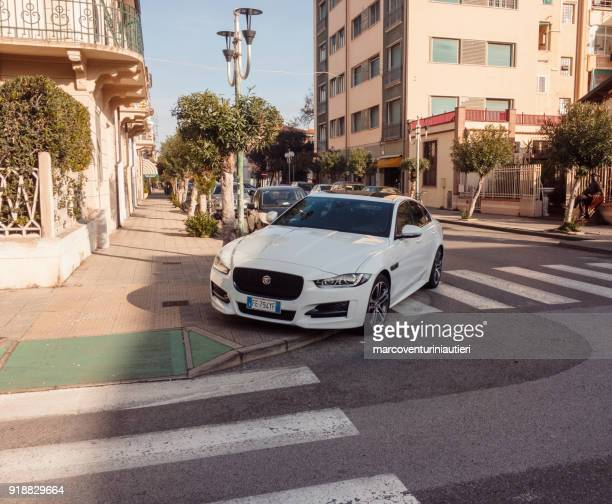 car parks on pedestrian crossing - evil stock pictures, royalty-free photos & images