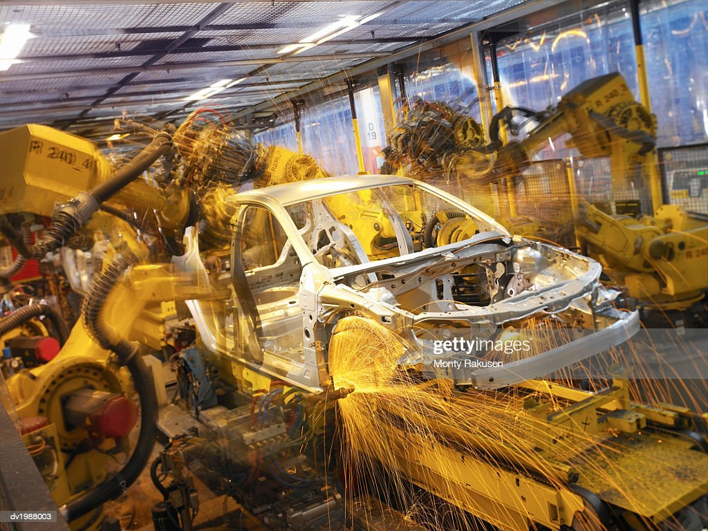 Car Part Being Welded by Automated Robots on an Assembly Line : Stock Photo