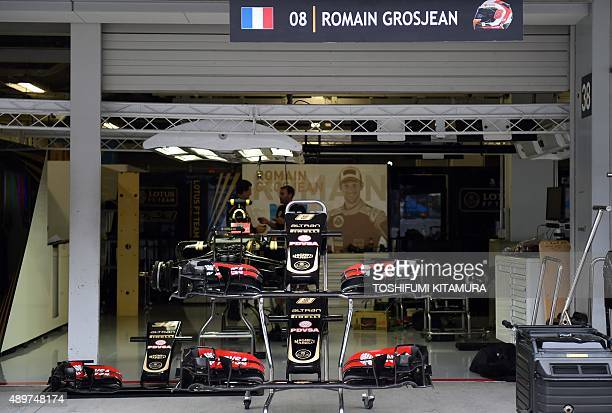 Car parts are placed in the pit of the Lotus F1 team ahead of the Formula One Japanese Grand Prix at the Suzuka circuit on September 24, 2015....