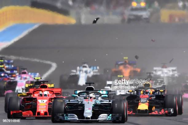 Car parts fly as drivers crash at the start of the Formula One Grand Prix de France at the Circuit Paul Ricard in Le Castellet southern France on...