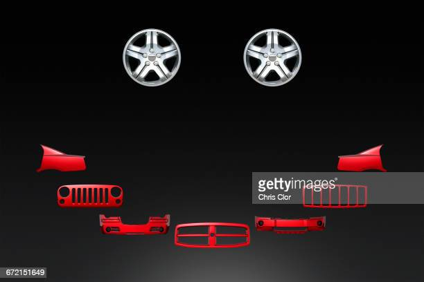 car parts forming smiley face on black background - vehicle grille stock pictures, royalty-free photos & images
