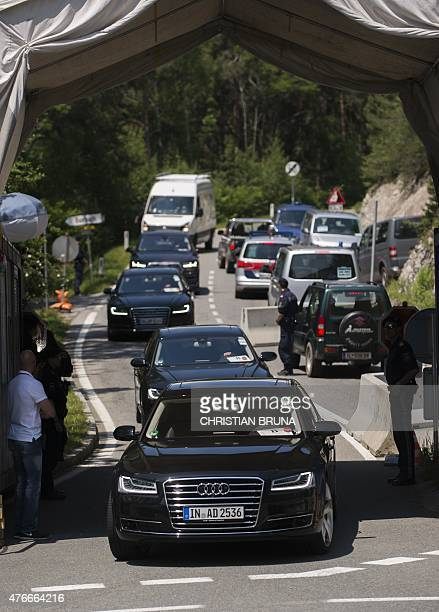 Car pass a checkpoint on a road leading to the InteralpenHotel Tirol venue of the Bilderberg conference on June 11 2015 near Telfs Austria The...