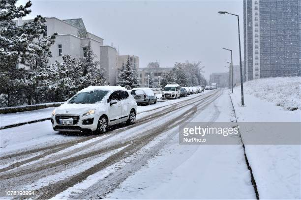 A car passes along a snowcovered road during a heavy snowfall in the winter season in Ankara Turkey on January 6 2019