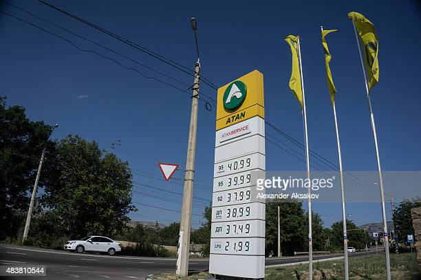 A car passes by a gas station on August 10 2015 in Yalta Crimea Russian President Vladimir Putin signed a bill in March 2014 to annexe the Crimean...