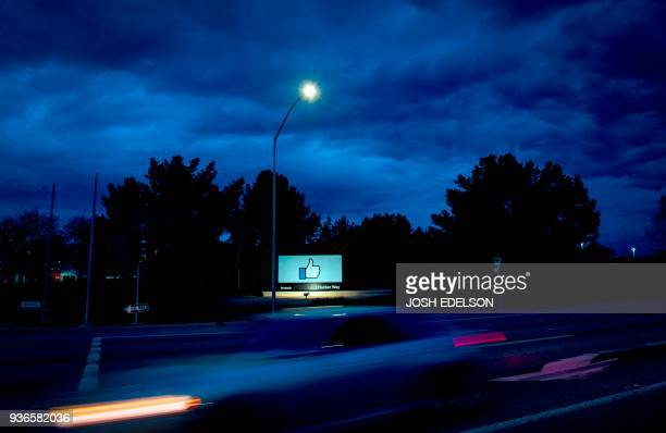 TOPSHOT A car passes by Facebook's corporate headquarters location in Menlo Park California on March 21 2018 Facebook chief Mark Zuckerberg vowed on...