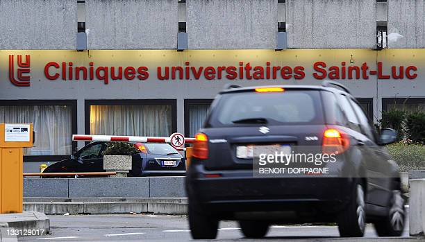 A car passes by the entrance of the 'Cliniques Universitaires SaintLuc' where Belgian King Albert underwent a minor surgery in Brussels on November...