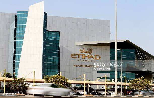 A car passes in front of headquaters of Etihad Airways in Abu Dhabi on March 13 2014 Alitalia and Etihad have been in talks for weeks on a possible...