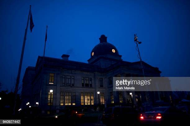 Car passes in front of the Montgomery County Courthouse before jury selection in the Bill Cosby sexual assault retrial on April 2, 2017 in...