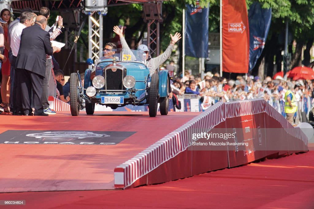 A car passes the finish line during the last day of the 1000 Miles Historic Road Race during Mille Miglia 2018 on May 19, 2018 in Brescia, Italy.
