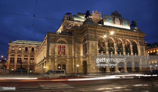 A car passes the illuminated Vienna Opera house on February 15 Vienna Austria The Vienna Opera Ball will take place there this evening