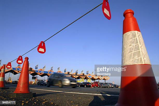 A car passes through a highway toll operated by Acesa Infraestructuras a subsidiary company of Abertis in Vilassar de Mar Spain on Friday July 21...