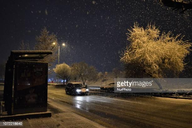 A car passes through a road during a heavy snowfall in the winter season in Ankara Turkey on December 12 2018