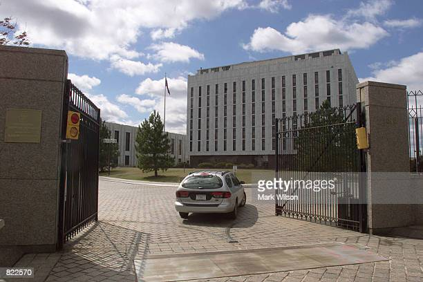 A car passes through the front gate of the Russian embassy March 22 2001 in Washington DC The United States announced Wednesday that 50 Russian...