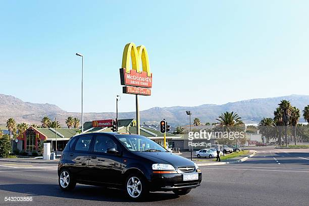 Car passing McDonalds branch in Tokai, a Cape Town suburb
