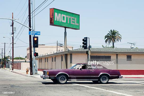 car passing motel in los angeles, california - motel stock photos and pictures