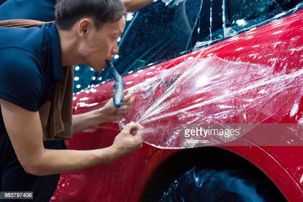 car pastes the membrane - man wrapped in plastic stock pictures, royalty-free photos & images