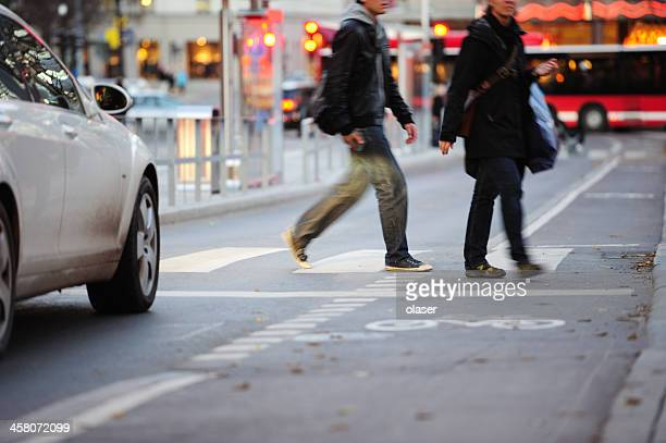 car, pedestrians and a zebra crossing - zebra crossing stock photos and pictures