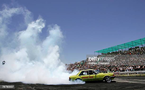 A car performs in the burnout competition during Street Machine Summernats 21 Car Festival at Epic Park on January 6 2008 in Canberra Australia...