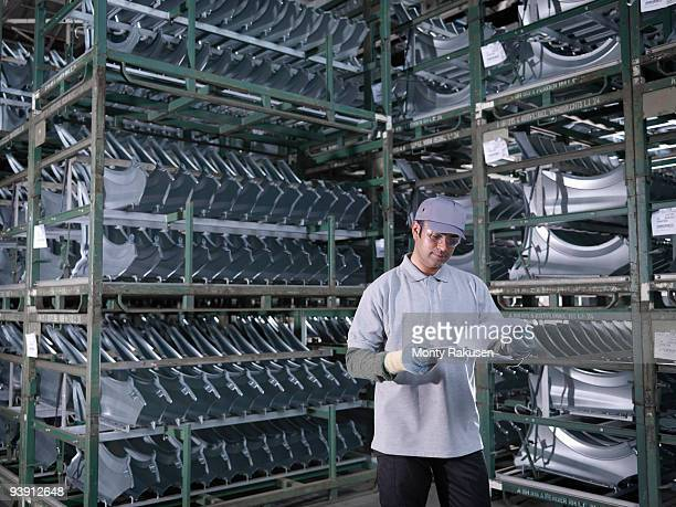 Car Plant Worker With Car Parts