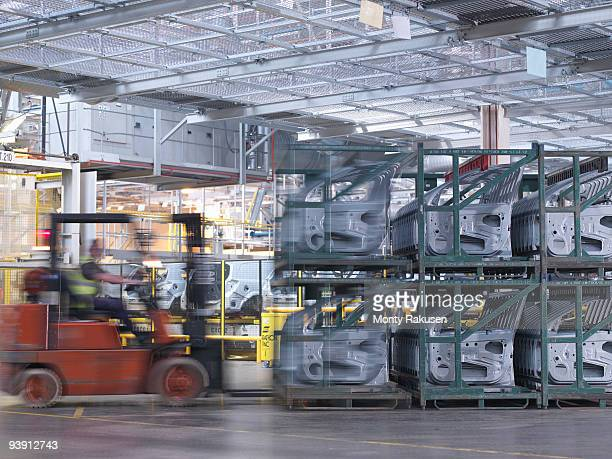 Car Plant Worker With Forklift Truck