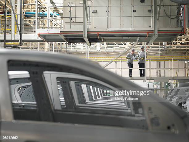 Car Plant Workers Observing Cars