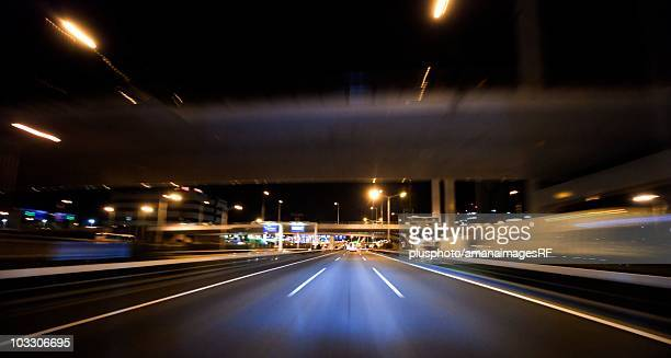 car point of view of a highway road at night. tokyo prefecture, japan - plusphoto stock pictures, royalty-free photos & images