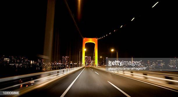 car point of view of crossing the rainbow bridge at night. tokyo prefecture, japan - plusphoto stock pictures, royalty-free photos & images