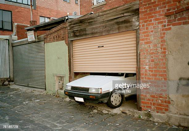 A car poking through a garage door