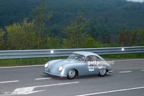 A car Porsche 356 1500 passes through the Passo della Futa during the 1000 Miglia Historic Road Race on May 17 2019 in Firenze Italy The 1000 Miglia...