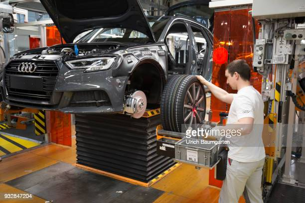 Car production at Audi AG in Ingolstadt Wheel assembly on the Audi A3/Q2