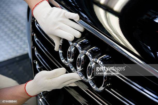 Car production at AUDI AG in Neckarsulm Initial startup and general examination of the AUDI A8 at the end of the assembly lineWorker at the AUDI logo