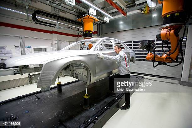 Car production at AUDI AG in Neckarsulm The finished AUDI A8 body in the measuring cell for A8 quality assurance Manual check