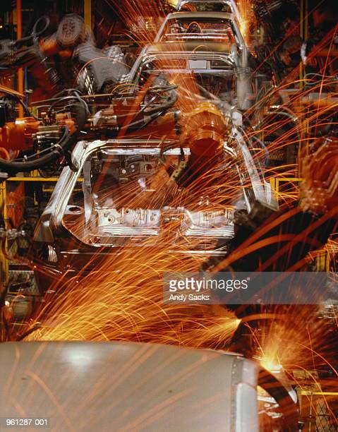Car production, automated assembly line (blurred motion)