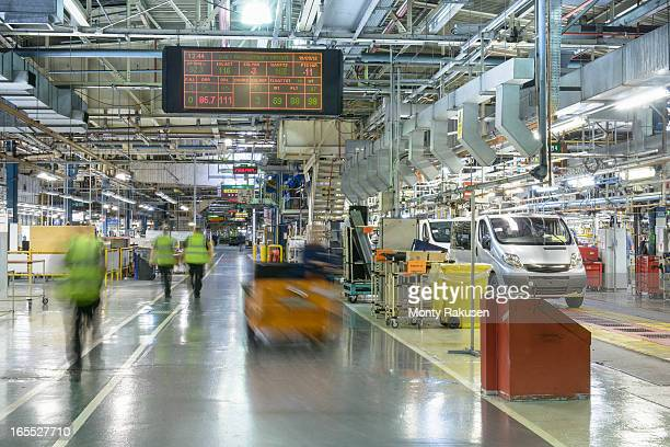 Car production line in car factory, blurred motion