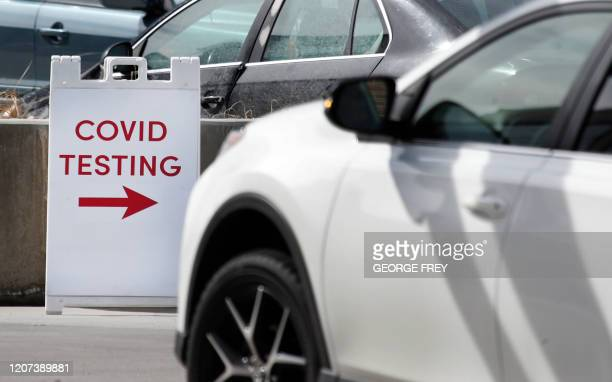Car pulls into one of the first drive through testing facilities for Coronavirus virus in a parking lot outside the University of Utah's Sugar House...