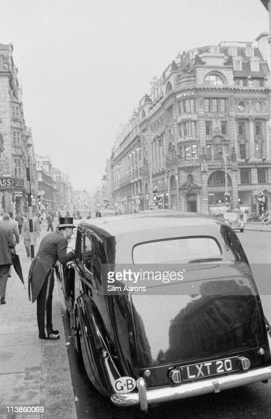 A car pulls up on Piccadilly in London 1955 On the right is the Norwich Union Building on the junction with St James' Street