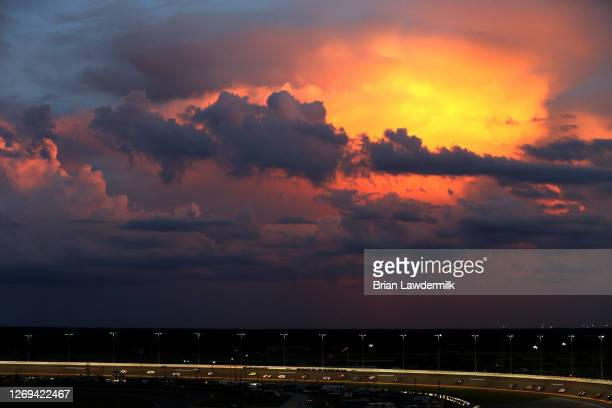 Car race as the sun sets during the NASCAR Xfinity Series Wawa 250 Powered by CocaCola at Daytona International Speedway on August 28 2020 in Daytona...