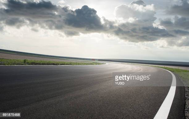 car racing - motor racing track stock photos and pictures