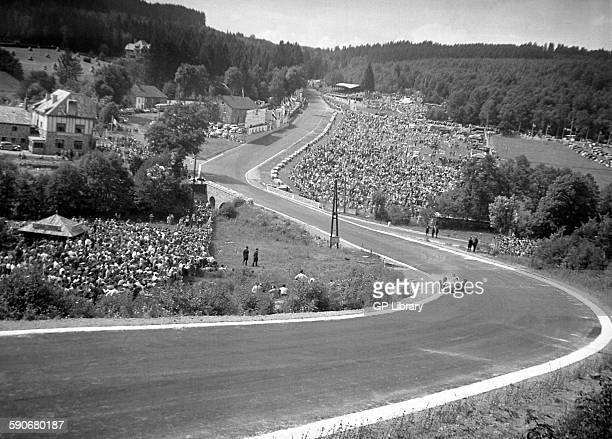 A car racing through Eau Rouge at the Belgian GP Spa 1950
