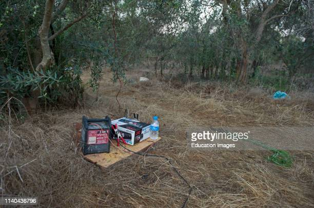 Car radio playing birdsong in orchard to attract and trap migrant songbirds for ambelopulia Cyprus