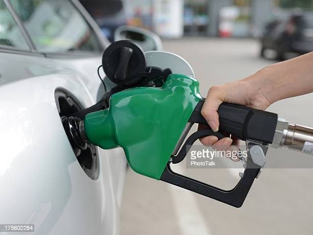car refueling - xxxxxlarge - gas tank stock photos and pictures