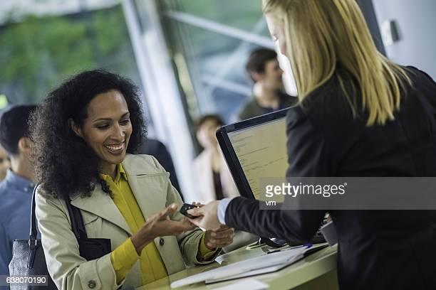 Car rental employee giving keys to customer