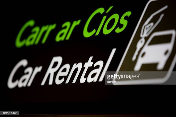 A car rental sign with a picture of a car and key