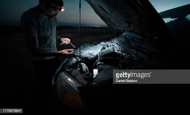 car repair. lucky me. fixing the car in the middle of nowhere at dusk. diy - emergencies and disasters stock pictures, royalty-free photos & images