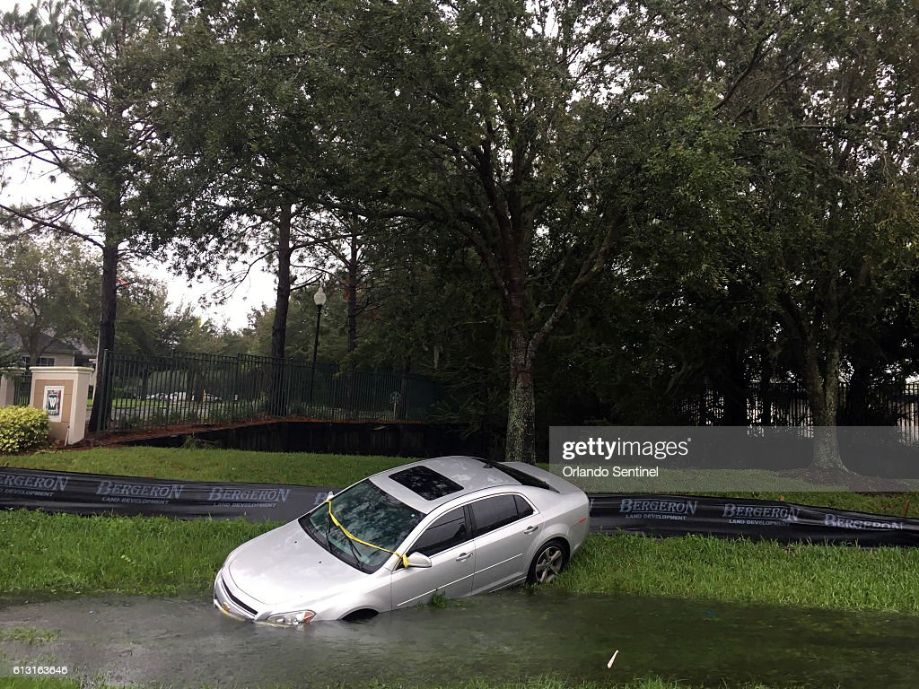 A car rests in a ditch off 17/92 in the Longwood/Lake Mary area in front of the Wyndham Place apartments on Friday, Oct. 7, 2016 in Longwood, Fla.